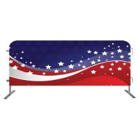 A steel barricade is covered with a shade cloth with national flag.
