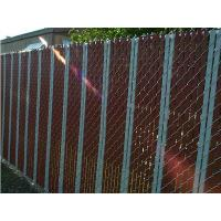 This is a chain link fence with slat that the slat is passing through chain link fence vertically.