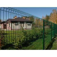 Wire mesh fences with square post surround the residence and grassland.