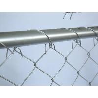 Chain link mesh wrapped around the frame of temporary chain link fence
