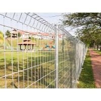 Roll top fence is used as a partition beside a road and a park.