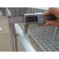 A hand is measuring the outer frame of crowd control barrier.