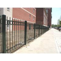 3-rail rod top steel tubular fence with decorative rings.