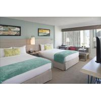 China Pattaya resort hotel fixed hotel furniture used melamine board bedroom furniture set with cabinets and fabric hotel sofa on sale