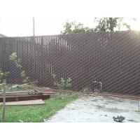This is a yard that has chain link fence with slat.