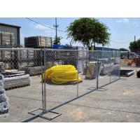 Several plastic pipes and equipment are in the area enclosed by temporary chain link fences.