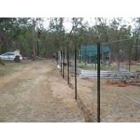 The construction site is surrounded by fence that is made of many star pickets and steel wires.