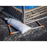There is a sand bag used to weight down the temporary chain link fence panels.