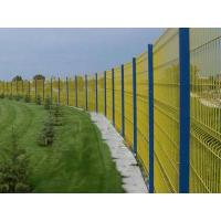A big garden park is surrounded by yellow curved wire mesh fences .