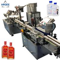 China Automatic gin filling machine with sprite whisky champagne gin spirits glass bottle filling and capping machine bottling on sale