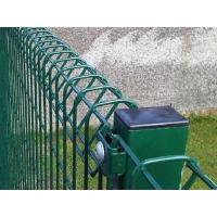 A part of green brc fence which connected with round post is in the picture.