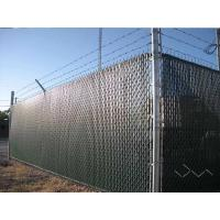 The chain link fence with slat is installed with razor wires.