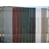 This is a chain link fence with various color slats.