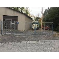 The equipment depot is protected by temporary chink link fence with gate.