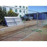 Temporary chain link fence with green fence feet installed in the factory yard.