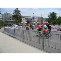 Bicycle race site with several crowd control barriers surrounding.