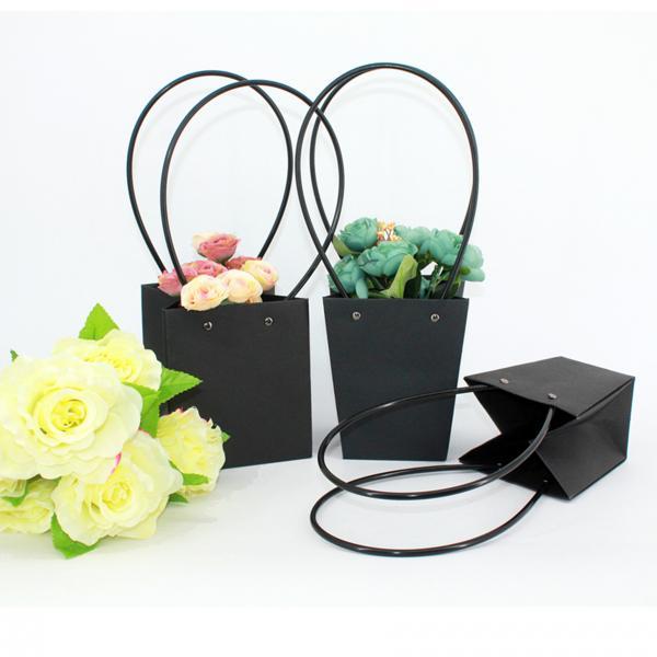 Buy Waterproof Flower Packaging Carry Kraft Paper Bag With Plastic Handle at wholesale prices