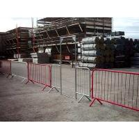 The construction site is protected by crowd control barrier with pedestrian gate.