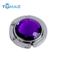 China Hot Sale Unique Cute Design Zinc Alloy Round Bag Holder for Cheap Promotional Items on sale