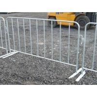 several hot dipped galvanized crowd control barriers are surrounding construction sites.