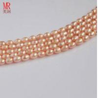 Quality 7-8mm Pink Rice Shape Freshwater Pearl Strands for sale