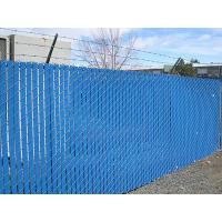 The factory is surrounded with blue chain link fence with slat.
