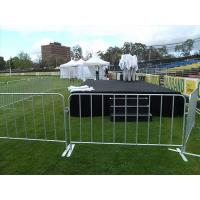 Several steel barricades are surrounding the concert stage.