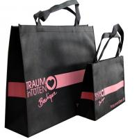 Quality 120gms Black Non Woven Carry Bag Silk Screen Printing Pink Logo for lady garment accesories for sale