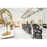 Quality Luxury fashion Makeup store interior fit outs by wooden Ivory counters with Bronzed metal craft display Showcase for sale