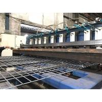 A piece of welded wire mesh panel is on the welded wire mesh machine.