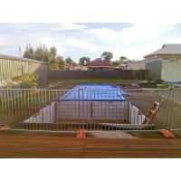 Temporary pool fencing are enclosing a pool construction site.