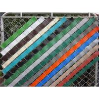 This is a chain link fence with slat that slat is passing through the chain link fence obliquely.