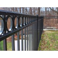 Black flat top ornamental steel tubular fence with decorative rings.