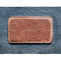 Quality custom embossed leather label for sale