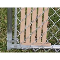 This is a chain link fence with slat that has bottom lock.