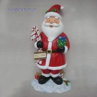 China RK12XS007 12 Inch Red Resin Santa Claus Statue Holding Candy Cane and Gift Box Christmas Decoration on sale